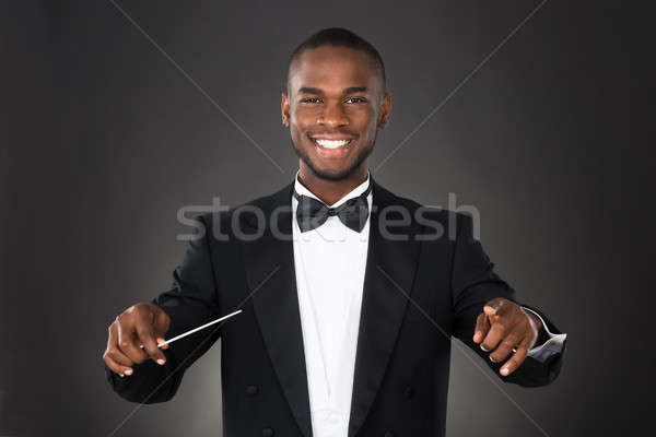 Portrait Of Music Conductor With Baton Stock photo © AndreyPopov