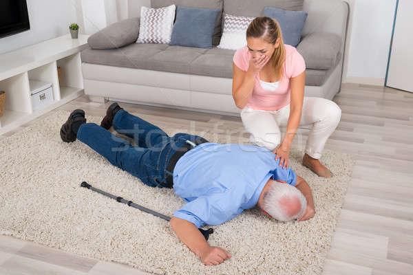 Kobieta patrząc niepełnosprawnych ojciec młoda kobieta Zdjęcia stock © AndreyPopov