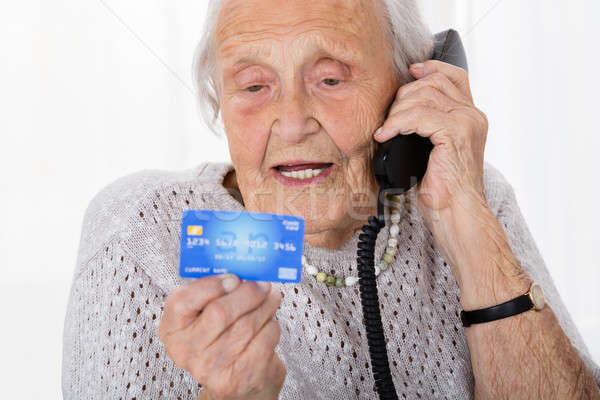 Senior Woman With Credit Card On Phone Stock photo © AndreyPopov