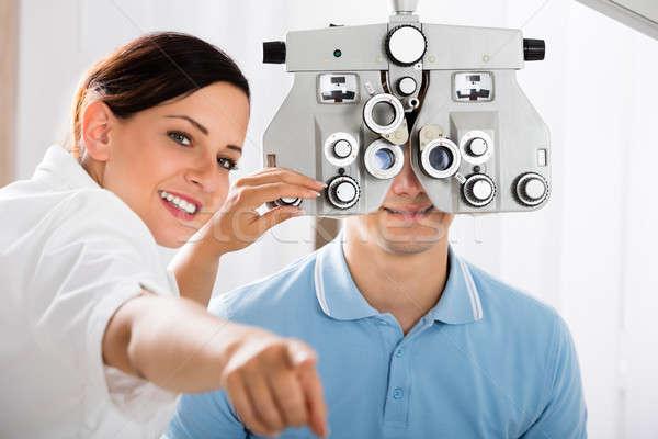 Női optometrikus látnivaló tesztelés beteg boldog Stock fotó © AndreyPopov