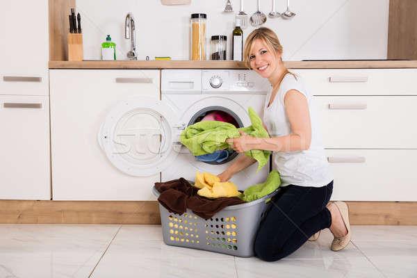 Nő ruházat mosógép fiatal nő konyha technológia Stock fotó © AndreyPopov