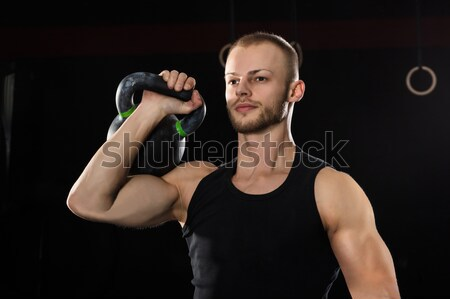 Man Exercising With Kettle Bell Stock photo © AndreyPopov