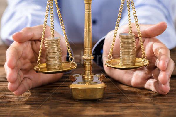 Személy igazság mérleg érmék közelkép személyek Stock fotó © AndreyPopov