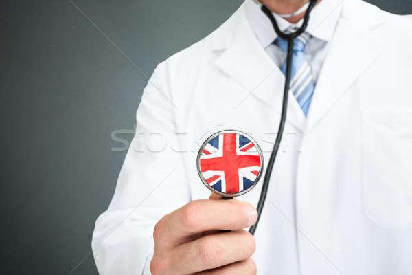Orvos tart sztetoszkóp angol zászló háttér kórház Stock fotó © AndreyPopov
