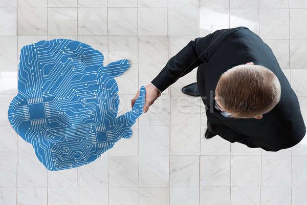 Iş adamı el sıkışmak dijital oluşturulan insan anlamaya Stok fotoğraf © AndreyPopov