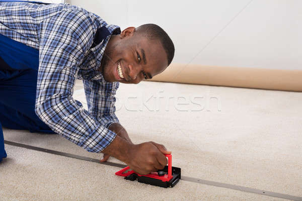 Young Craftsman Fitting Carpet Stock photo © AndreyPopov