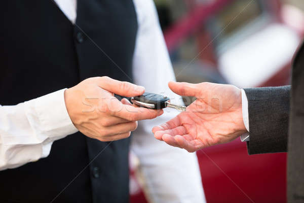 Valet Giving Car Key To Businessperson Stock photo © AndreyPopov