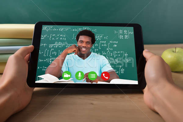 Student Video Conferencing With Teacher On Digital Tablet Stock photo © AndreyPopov