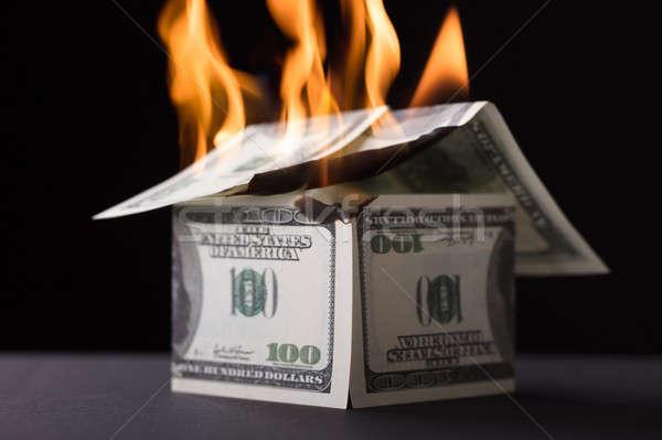 Ház felfelé bankjegy égő tűz fekete Stock fotó © AndreyPopov
