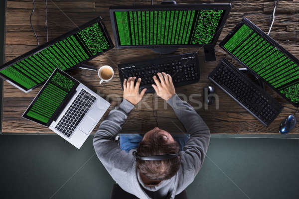 Hacker Stealing Data From Multiple Computer Stock photo © AndreyPopov