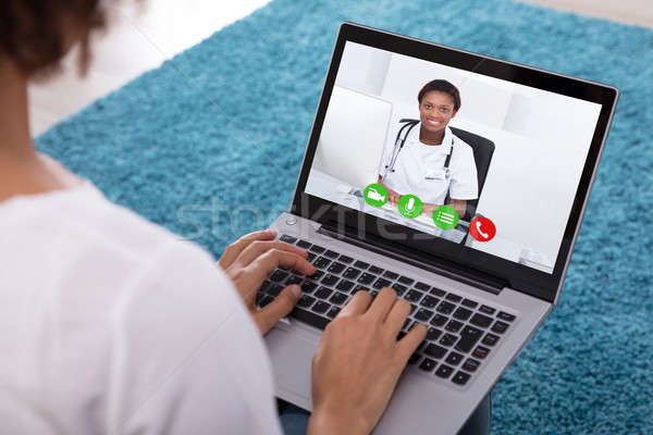 Woman Video Conferencing With Doctor On Laptop Stock photo © AndreyPopov