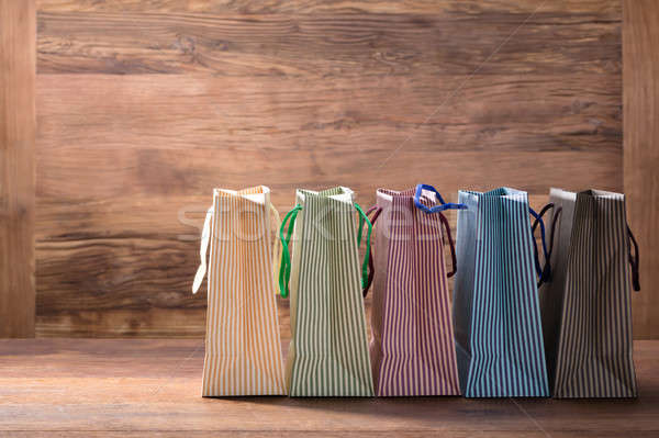 Colorful Striped Shopping Bags In Row Stock photo © AndreyPopov