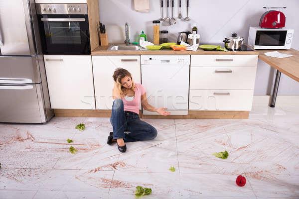 Woman Sitting On Messy Kitchen Floor Stock photo © AndreyPopov