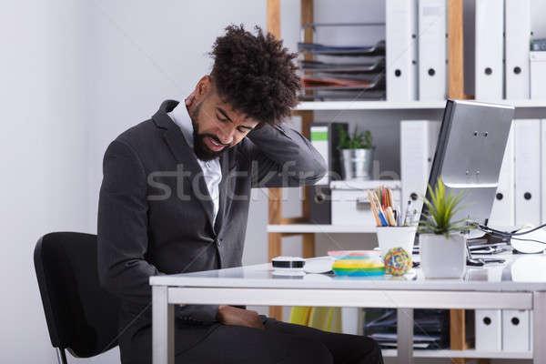 Işadamı boyun ağrısı genç oturma ofis Stok fotoğraf © AndreyPopov