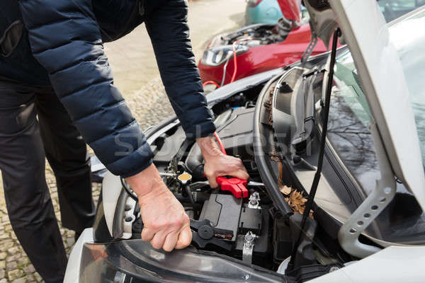 Person Using Jumper Cables To Charge Car's Dead Battery Stock photo © AndreyPopov