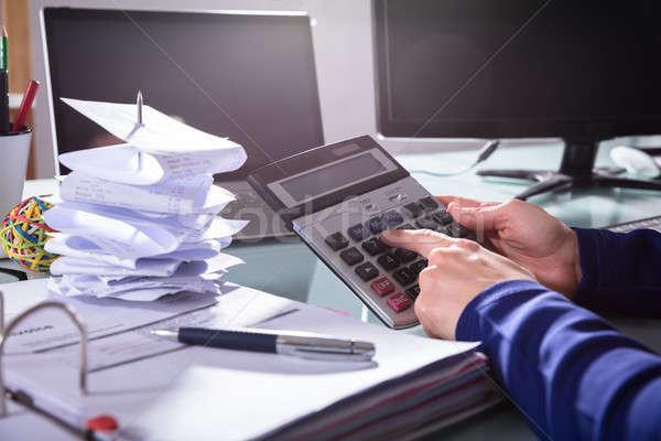 Businessperson Using Calculator Stock photo © AndreyPopov