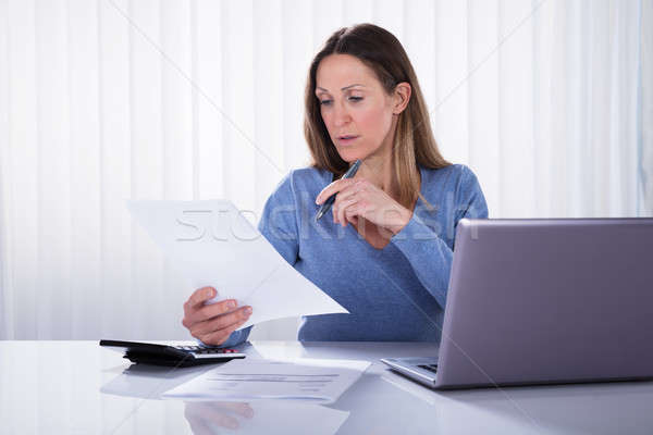Woman Calculating Invoice With Calculator At Home Stock photo © AndreyPopov