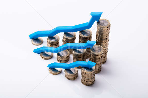Stacked Golden Coins With Increasing Arrows Stock photo © AndreyPopov