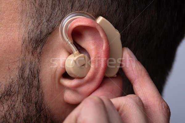 Férfi hallókészülék fül közelkép kéz egészség Stock fotó © AndreyPopov