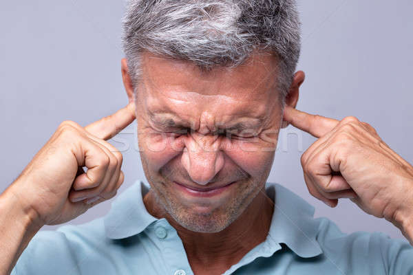 Man Covering His Ears With Fingers Stock photo © AndreyPopov