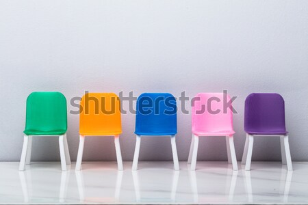 Increasing Size Of Colorful Chairs Stock photo © AndreyPopov