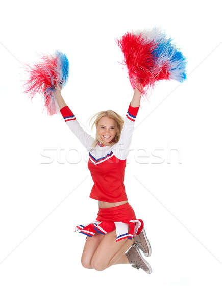 Smiling beautiful cheerleader with pompoms. Stock photo © AndreyPopov
