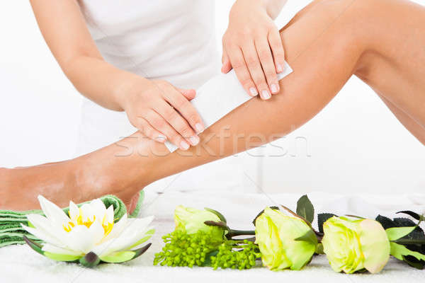 Beautician Waxing A Woman's Leg Stock photo © AndreyPopov