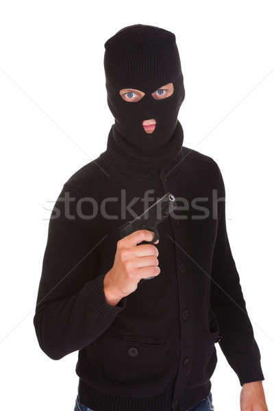 Burglar Holding Hand Gun Stock photo © AndreyPopov