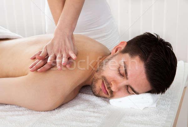 Uomo trattamento termale massaggio spa centro ragazza Foto d'archivio © AndreyPopov