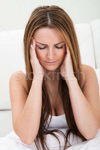 Portret młoda kobieta cierpienie głowy kobieta młodych Zdjęcia stock © AndreyPopov