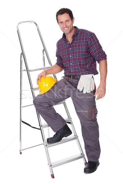 Jovem trabalhador homem escada Foto stock © AndreyPopov