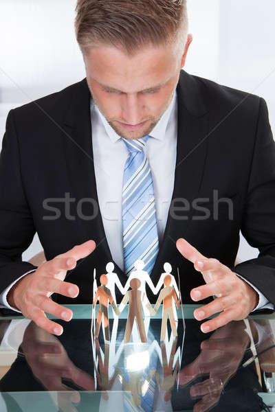 Empresário cuidar papel pessoas foto Foto stock © AndreyPopov