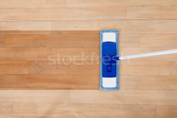 Mop cleaning a wooden floor Stock photo © AndreyPopov