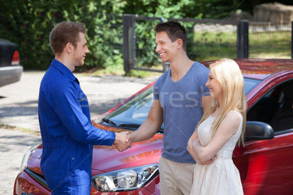 Mechanic Handshaking With Couple By Car Stock photo © AndreyPopov