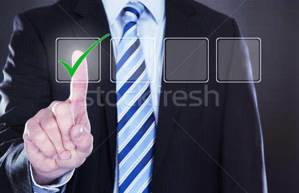 Businessman Pressing Check Mark Button Stock photo © AndreyPopov