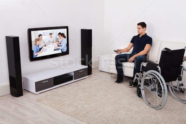Handicap Man Watching Television In Living Room Stock photo © AndreyPopov