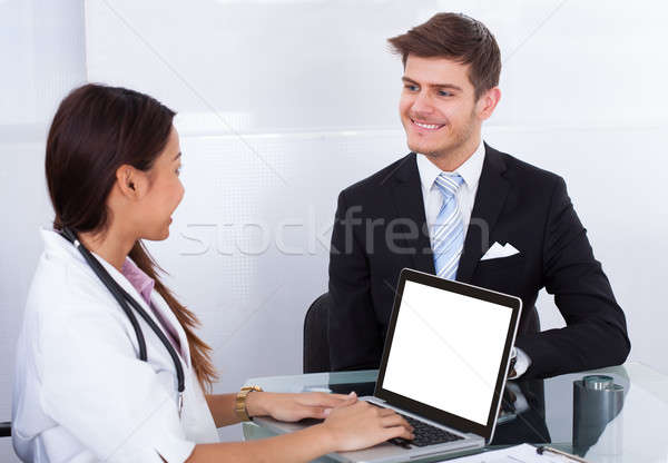 Businessman Consulting Doctor Stock photo © AndreyPopov