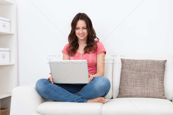 Stock photo: Young Woman Using Laptop