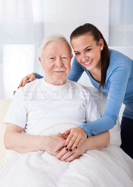 Caretaker With Senior Man At Nursing Home Stock photo © AndreyPopov