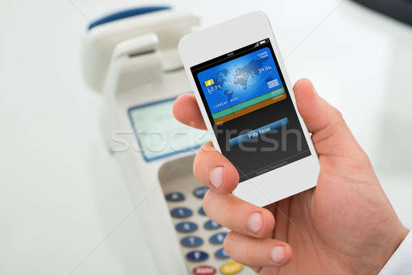 Businessman's Hand Paying Through Mobilephone Stock photo © AndreyPopov