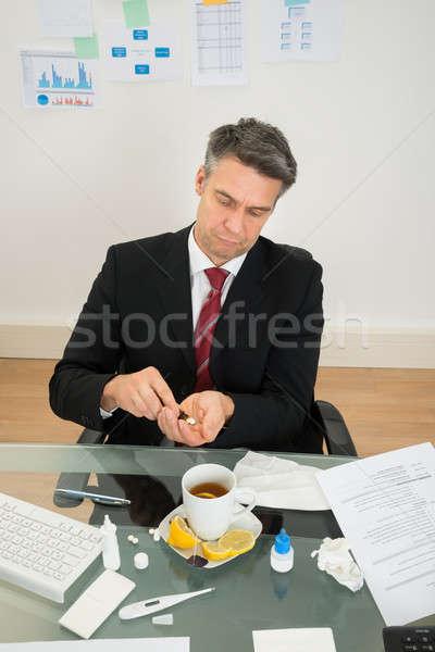 Businessman Taking Medicines Stock photo © AndreyPopov