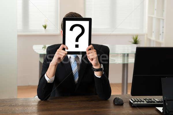 Empresario bordo signo de interrogación jóvenes cara Foto stock © AndreyPopov