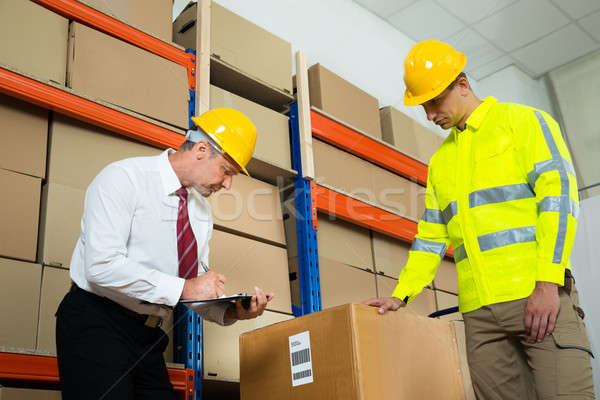Manager Checking List With Worker In Warehouse Stock photo © AndreyPopov