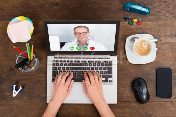 Person Videochatting With Doctor On Laptop Stock photo © AndreyPopov