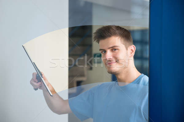 Worker Cleaning Glass With Squeegee Stock photo © AndreyPopov