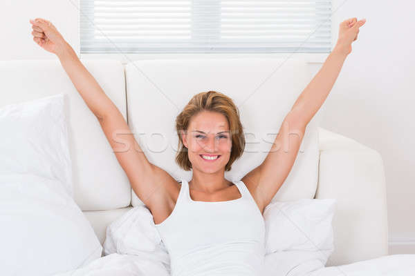 Happy Woman Stretching Arms Stock photo © AndreyPopov