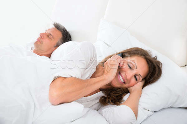 Woman Busy On Phone While Man Sleeping Stock photo © AndreyPopov