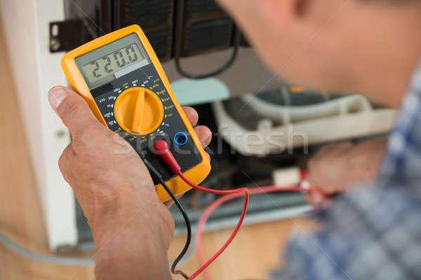 Repairman Checking Fridge With Digital Multimeter Stock photo © AndreyPopov