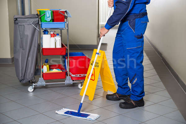 Janitor With Broom Cleaning Office Corridor Stock photo © AndreyPopov