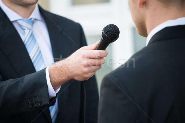 Journalist Taking Interview Of Businessman Stock photo © AndreyPopov